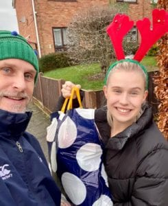 Father Christmas and Daughter deliver food packages